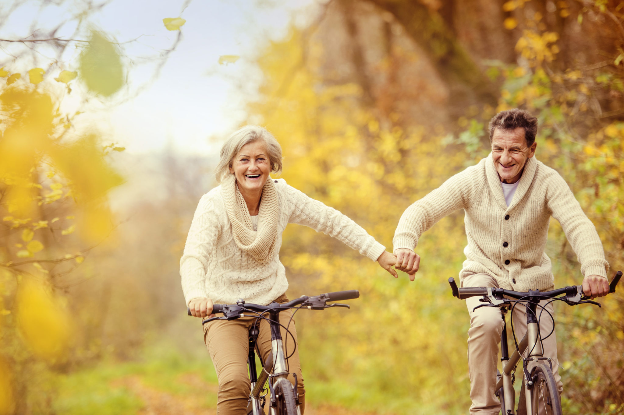Seniors couple having fun on a bike ride